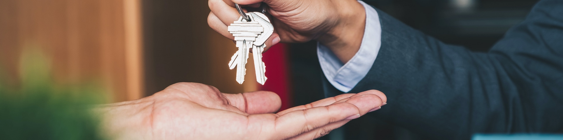 Real estate agent handing over keys to a home